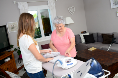 two women ironing some clothes