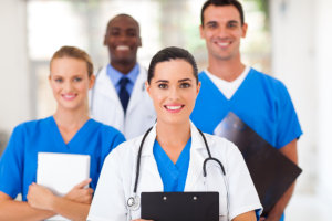 four medical staff smiling