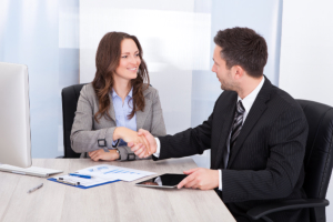 professional woman and man handshaking